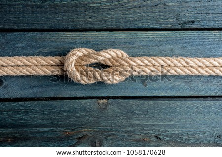Square knot. Nautical rope knot Royalty-Free Stock Photo #1058170628
