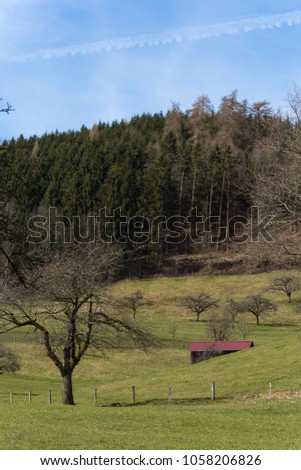 nature landscape of wanderlust in south germany rural countryside at easter springtime holiday sunny blue sky morning #1058206826