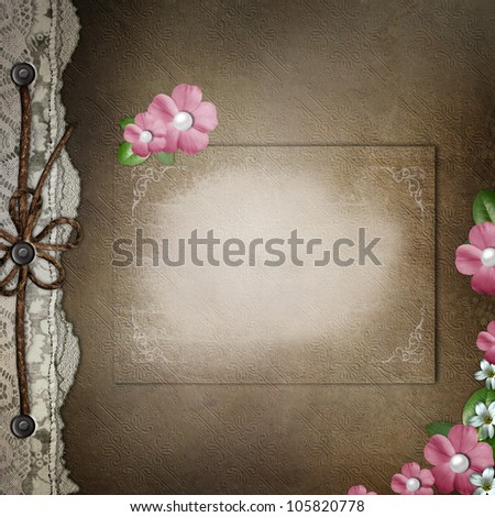 Brown cover for an album with lace, card, pink  flowers