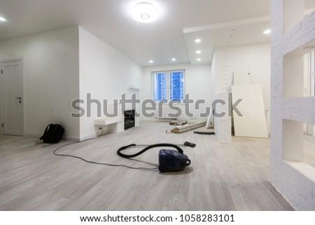 Repairs in the apartment vacuum cleaner on the floor #1058283101
