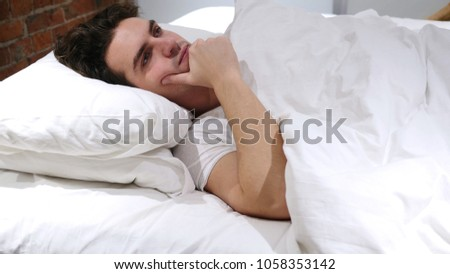 Man in Lying in Bed Thinking and Imagining at Night #1058353142