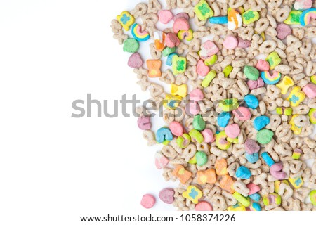 Frosted toasted oat cereal with fun shaped marshmallows on white background. blank space for texts. Royalty-Free Stock Photo #1058374226