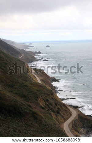 Highway One, Big Sur, on a rainy day. Royalty-Free Stock Photo #1058688098