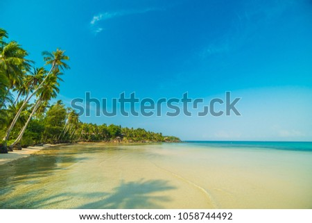 Beautiful paradise island with beach and sea around coconut palm tree at sunset time - Holiday Vacation concept #1058744492
