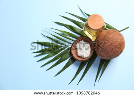 Composition with coconut oil on color background #1058782046