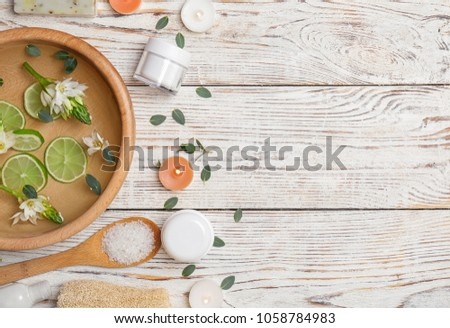 Composition with spa accessories and flowers on wooden background #1058784983