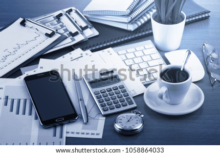 Items for business and accounting in the composition in the office on the table #1058864033