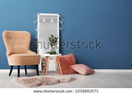 Elegant room interior with comfortable armchair. House design #1058882075