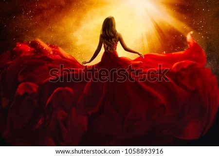 Fashion Model Back Side in Red Flying Dress, Woman Rear View, Gown Fabric Fly on Wind, Beautiful Girl Looking to Light Royalty-Free Stock Photo #1058893916