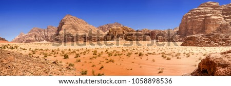 Composite panorama of high resolution aerial photos of a monolithic mountain in the central area of the desert reserve of Wadi Rum, Jordan, middle east