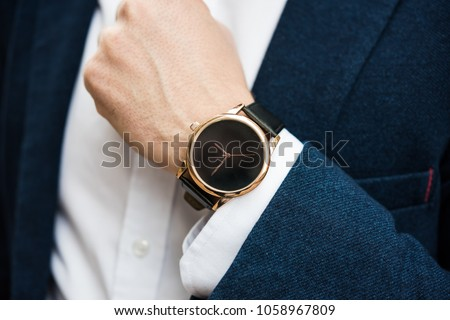 Elegant man in blue suit, business man's hand with fashion no br Royalty-Free Stock Photo #1058967809