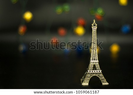 Eiffel tower isolated on black background. #1059061187