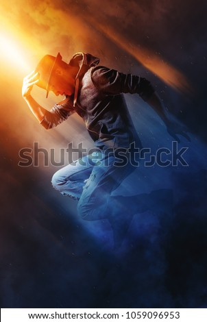 Young man break dancing on smoke background #1059096953