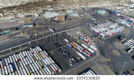 Aerial photo of Dover harbor lorries trucks ready for embarking the ferry the Port of Dover is the cross-channel port situated in Dover Kent south-east England busy industrial scene #1059130820