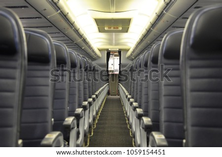 737 Cabin interior and blue leather seats on commercial airline #1059154451