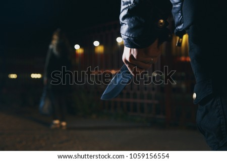 crime concepts robbery concepts a robber aimed his sharp knife at a woman to rob her valuable things in bag #1059156554