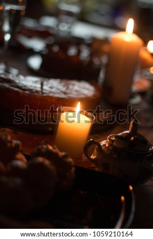 cozy family dinner coffee table with candles and pastry #1059210164