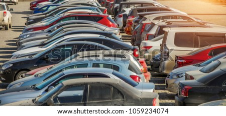 parked used cars stand on street during the day Royalty-Free Stock Photo #1059234074