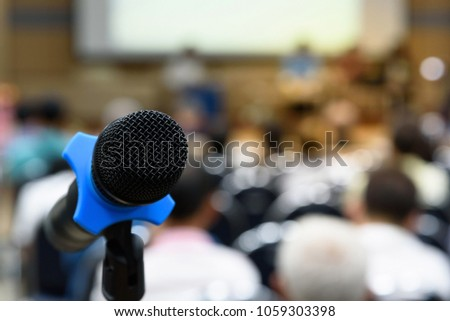 Selective focus microphone in conference hall or meeting room and blurry attendee for seminar business event. #1059303398