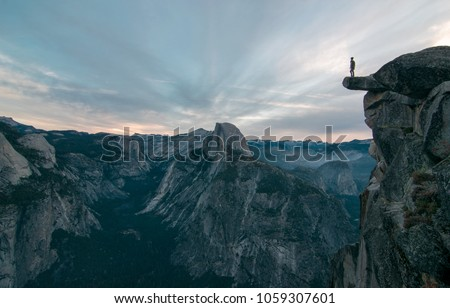 Perhaps the best view of glacier point where this unknown adventurer dares to stand on the edge of a precipice #1059307601