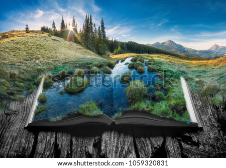 Alpine mountain valley in a light of sunrise on the pages of an open magical book. Majestic landscape. Nature concept. #1059320831