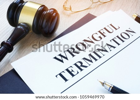 Documents about wrongful termination and gavel. Royalty-Free Stock Photo #1059469970