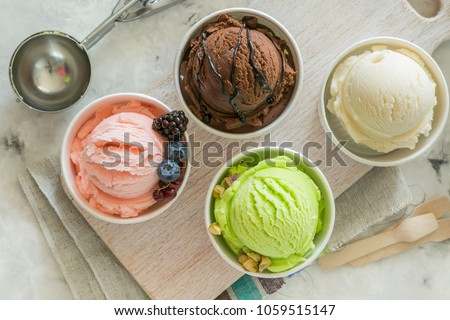 Selection of colorful ice cream scoops in paper cones, copy space #1059515147