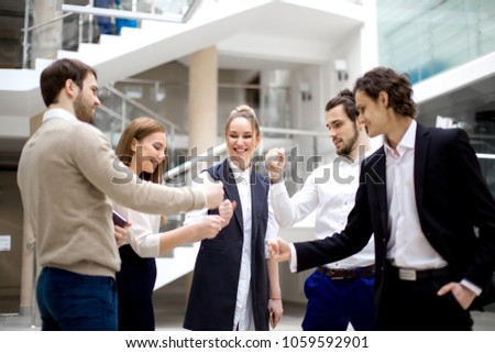 happy business team playing rock paper scissors at modern office #1059592901