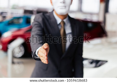 Dishonest and evil salesman in business suit in car dealership company handshaking welcome customers to exploit and deceive customers - fraud and bad quality service in business concept #1059618683