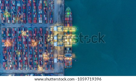 Container ship in export and import business and logistics. Shipping cargo to harbor by crane. Water transport International. Aerial view #1059719396