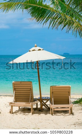 comfortable chair on the beach, modern umbrella, clear sky and sea, copy space. #1059803228