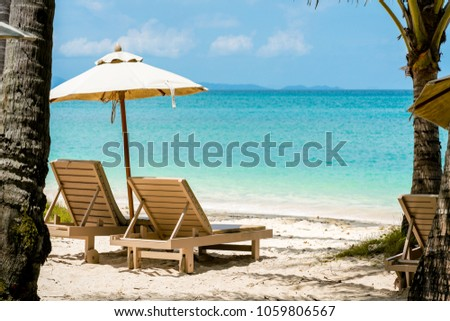 comfortable chair on the beach, modern umbrella, clear sky and sea, copy space. #1059806567
