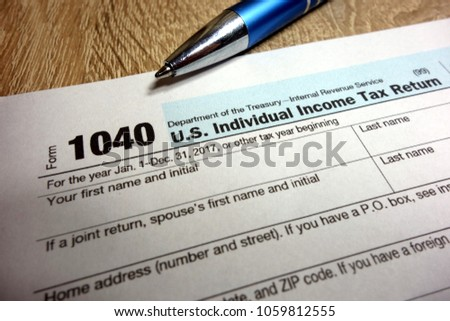 US tax form 1040 and pen #1059812555