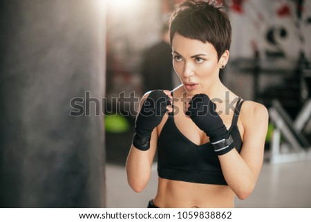 closeup shot of muscular woman learning to beat with fists indoors. practising hits.sparring #1059838862