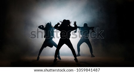 Group of young hip-hop dancers performing on the stage. effective performance. beautiful dance. full of energe dancers #1059841487