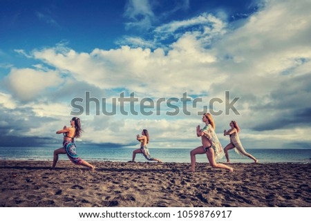Four girls are on the beach having fun, enjoying their summer holiday like best friends. #1059876917