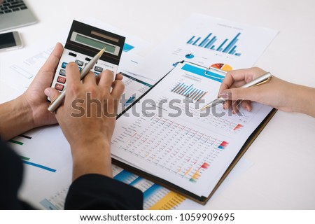 Asian business adviser meeting to analyze and discuss the situation on the financial report in the meeting room.Investment Consultant,Financial Consultant,Financial advisor and accounting concept #1059909695