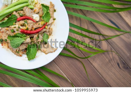 Spicy minced pork on gray wood table,top view #1059955973
