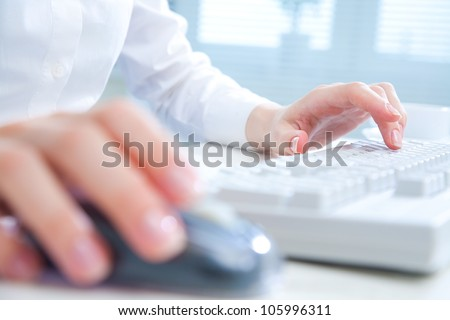 Detail of female hands using a computer on office background #105996311