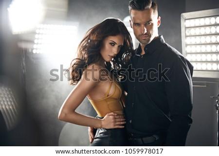 Closeup portrait of a sensual woman seducing her handsome lover #1059978017