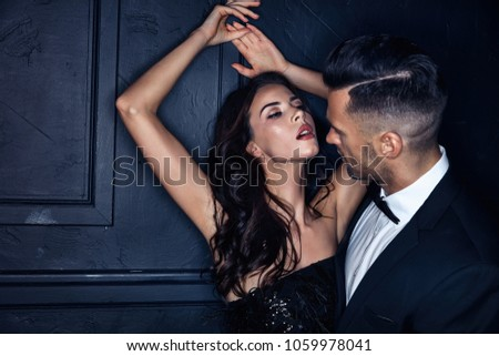 Portrait of a sexy woman seducing her handsome lover #1059978041