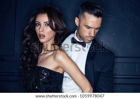 Closeup portrait of an elegant, stylish, young couple #1059978047