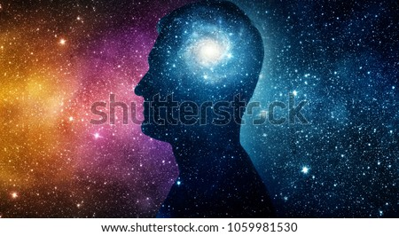 The universe within. Silhouette of a man inside the universe. The concept on scientific and philosophical topics.  Elements of this image furnished by NASA. #1059981530