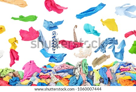 Separate clothing falling at the big pile of clothes on a white background #1060007444