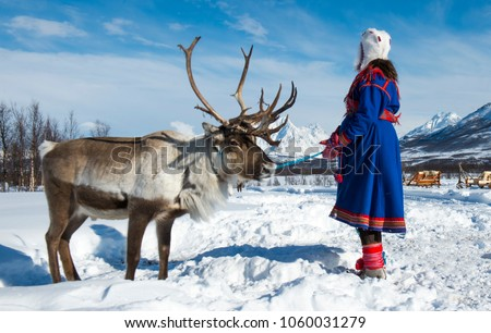 Northern Norway, a traditional dressed Sami woman .Tromso Lapland #1060031279