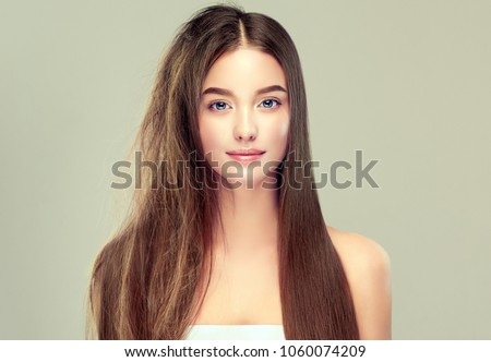 Hair care . Keratin straightening ,smoothing and treatment of the hair .  Girl with straight and smooth hair on one side of the head . The second side of the head tangled and un brushed hair .  #1060074209