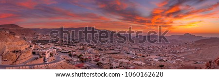 Wadi Musa, city of Petra in Jordan. Beautiful sunset over Wadi Musa, town located in Ma'an Governorate in southern Jordan. It is the administrative center of the archaeological site of Petra. #1060162628