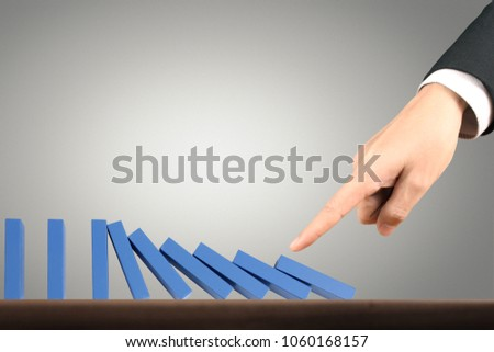 Hand Stopping domino concept , business solution #1060168157