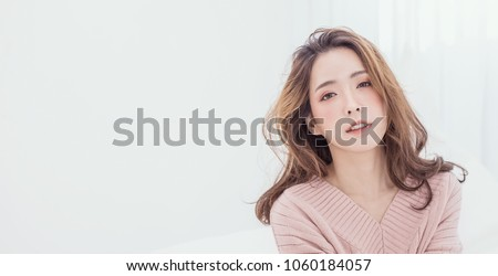 Portrait of young beautiful makeup asian woman relax pink face. Smile happy asian beauty teenage girl on winter background banner. Makeup Japanese Chinese hygge lifestyle facial treatment glow skin  Royalty-Free Stock Photo #1060184057