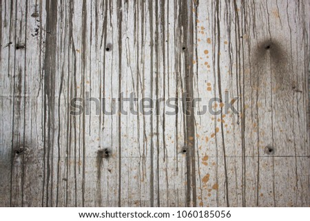 The grey color rough concrete wall with line of cement drops on its surface #1060185056